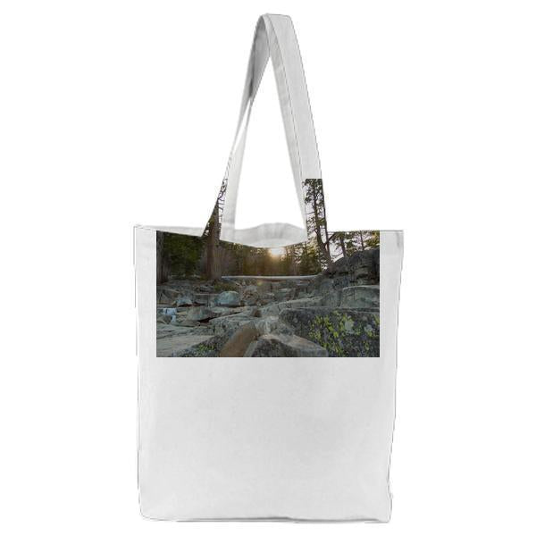 Green Leaf Tree And Rocks During Daytime Tote Bag