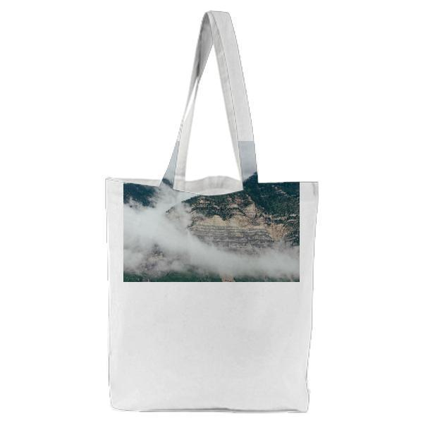 Green And Brown Mountains Covered Of Clouds During Daytime Tote Bag
