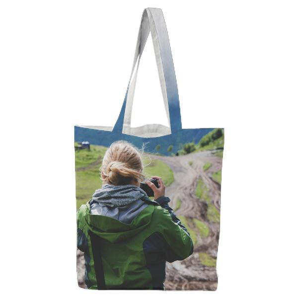 Woman In Green And Black Jacket Taking Photos Of The View During Daytime Tote Bag