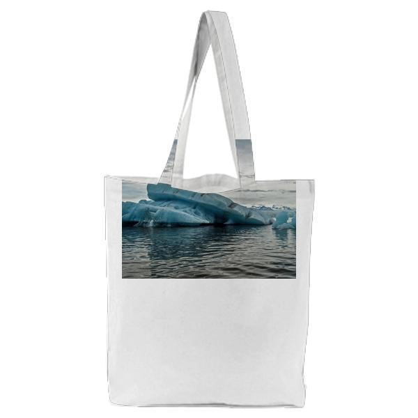 Iceberg Surrounded By Body Of Water Tote Bag