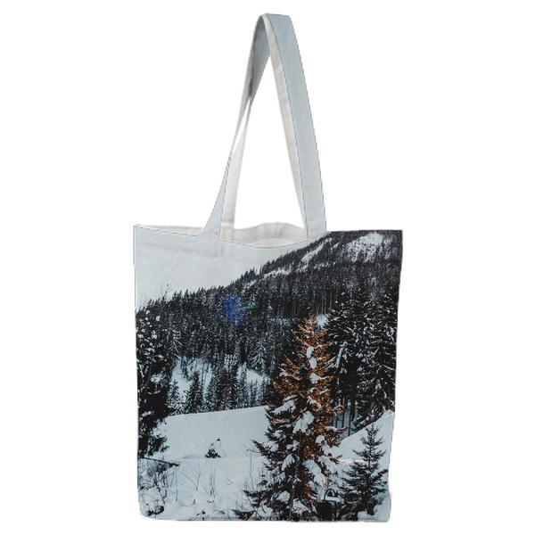 Snow Covered Trees Against Sky Tote Bag