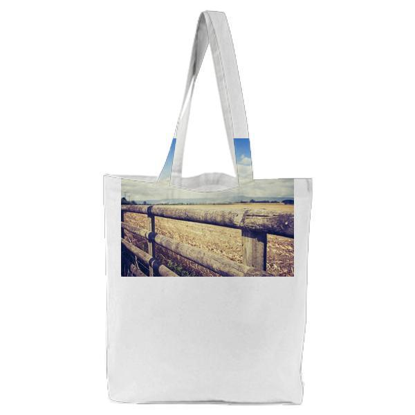 Brown Wooden Fence Under Cloudy Sky During Daytime Tote Bag