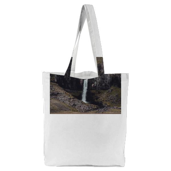 Waterfall Between Mountain Hill During Daytime Tote Bag
