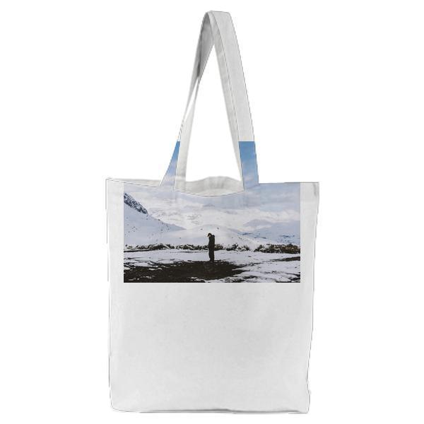 Man In Black Shirt Standing On White Snow Field Tote Bag