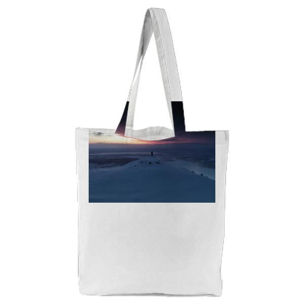 Person Standing On Snowy Cliff Near Sea Ocean During Night Time Tote Bag