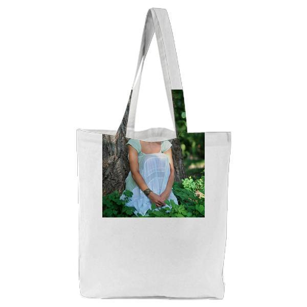 Smiling Woman Wearing Green Leaf Crown With And White Sleeveless Dress Sitting In During Day Time Tote Bag