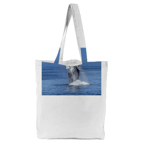 Black And White Dolphin On Body Of Water During Daytime Tote Bag