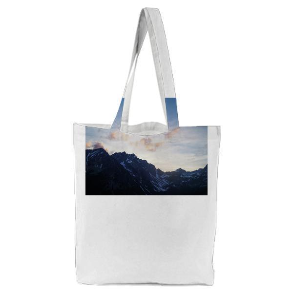 Black Mountain With White Snow Under Blue Sky Tote Bag