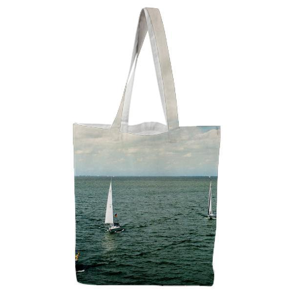 White Sail Boat On Body Of Water Under Blue Cloudy Sky During Daytime Tote Bag