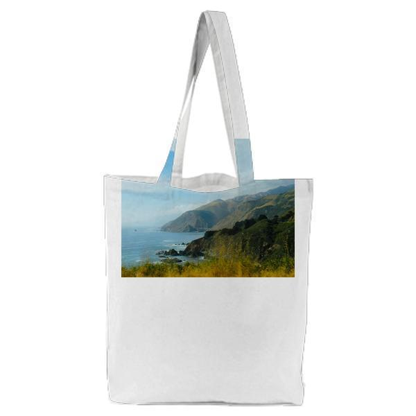 Blue Ocean Beside Green Mountain Tote Bag
