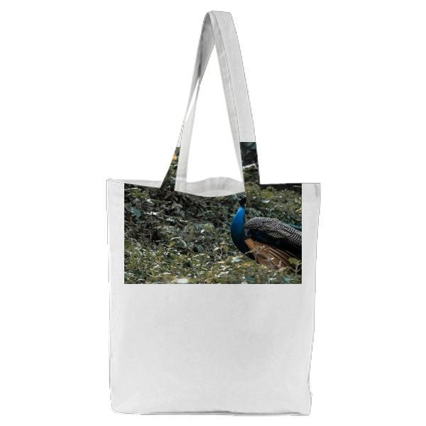 Blue Peacock On Green Grass Field During Daytime Tote Bag