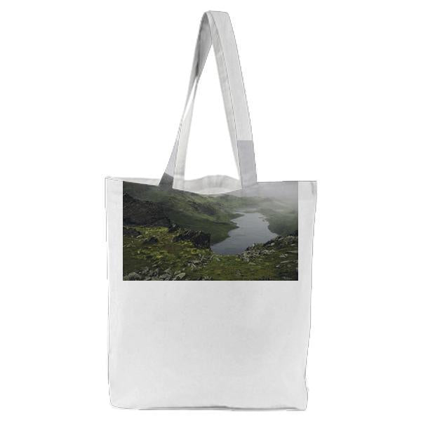 Green And Brown Mountain Near Lake During Foggy Day Tote Bag