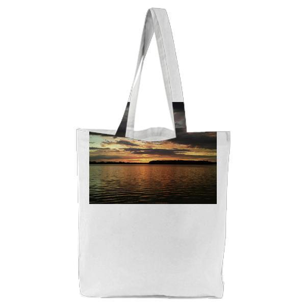 Body Of Water Under Gray And White Cloudy Sky During Sunset Tote Bag