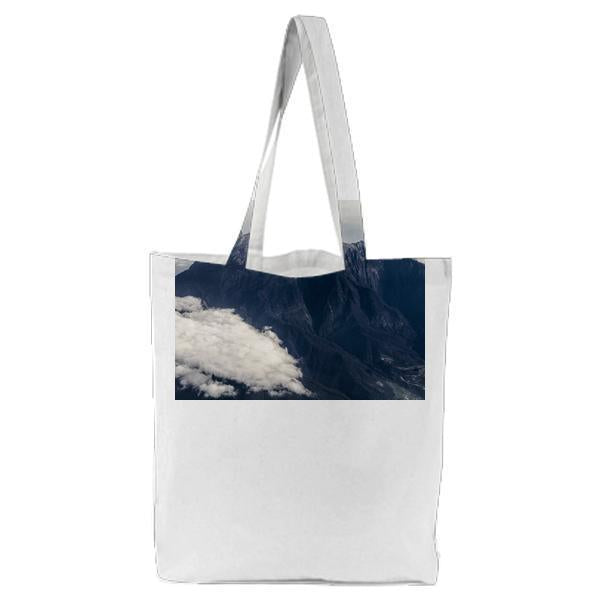 White Clouds Near Gray Mountain At Daytime Tote Bag