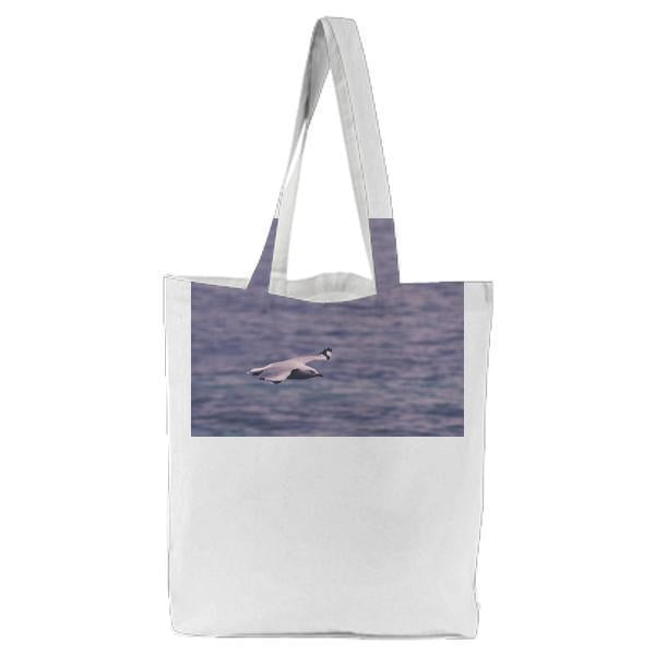 Seagull Flying Across Body Of Water Tote Bag