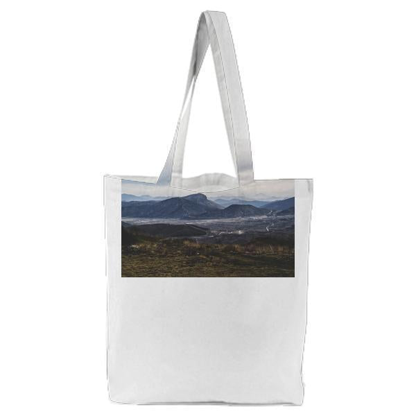 Gray Mountains And Brown Green Weeds Grass Tote Bag