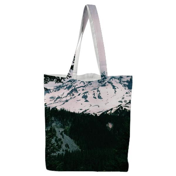 White And Blue Mountain Near Green Leaf Trees Under Cloudy Sky During Daytime Tote Bag