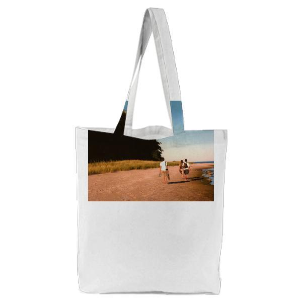 3 People Standing On Brown Beach Tote Bag
