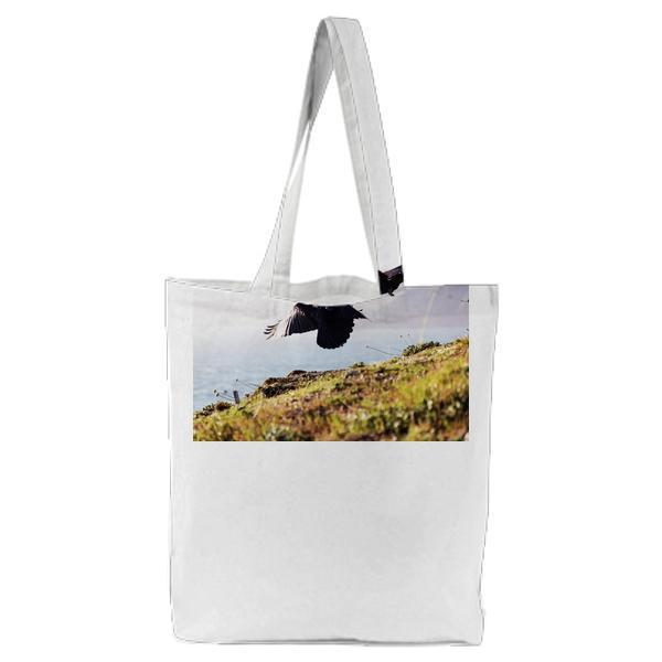 2 Eagle Near Green Grass And Cliff During Daytime Tote Bag