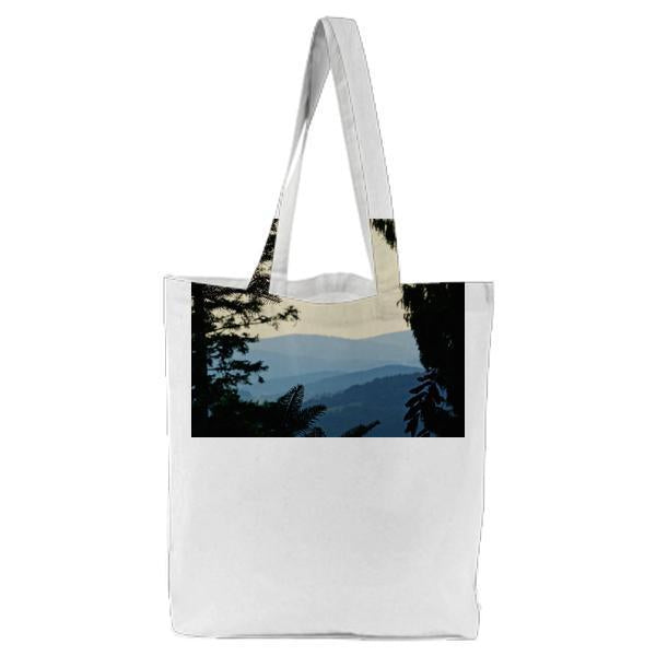 Silhouette Of Trees With Mountain On Distant Tote Bag