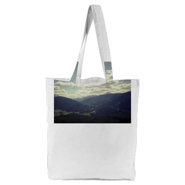 Black Mountain Range Under Gray Cloudy Sky During Daytime Tote Bag