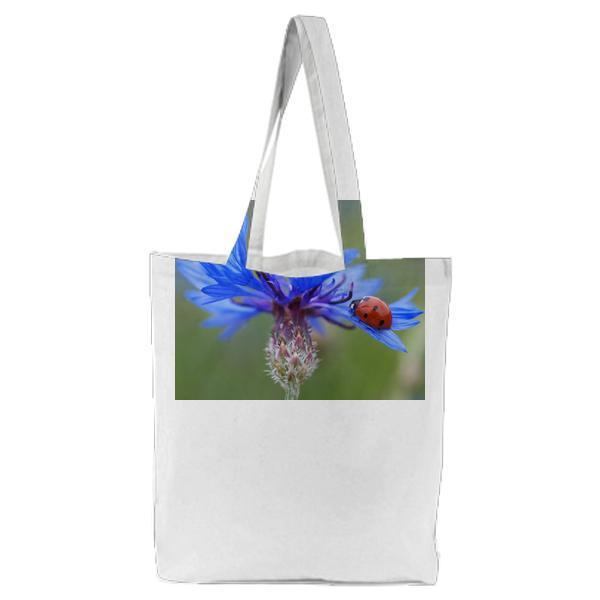 Red And Black Lady Bug On Purple Flower During Daytime Tote Bag