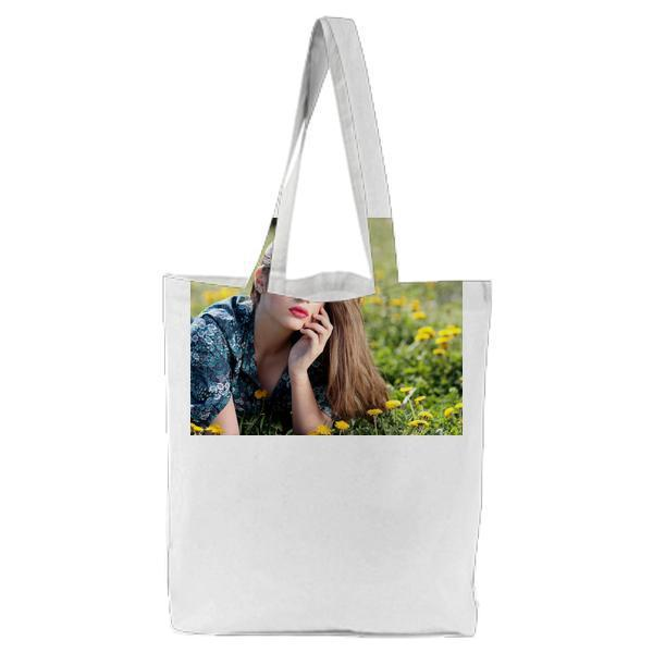 Girl Lying On Yellow Flower Field During Daytime Tote Bag