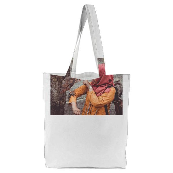 Woman In Red Hijab And Orange Coat Touching Brown White Owl Tote Bag