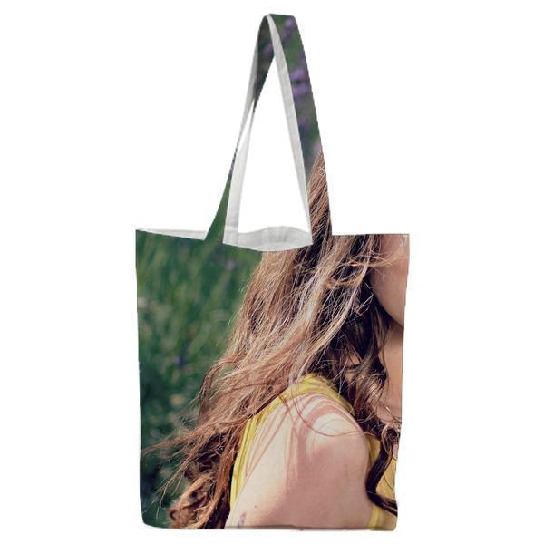QuotWomens Yellow Tank Top Holding Her Brown Curly Hair While Sitting On A Purple Flower Tote Bag