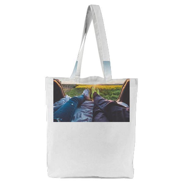 2 People Sitting With View Of Yellow Flowers During Daytime Tote Bag