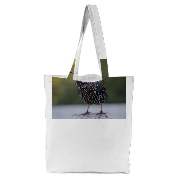 Shallow Focus Photography Of Black And Teal Bird Tote Bag