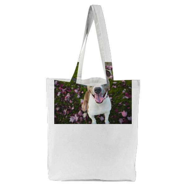 Photography Of White And Grey Short Coated Dog Sitting On Green Pink Leaf Covered Ground During Daytime Tote Bag