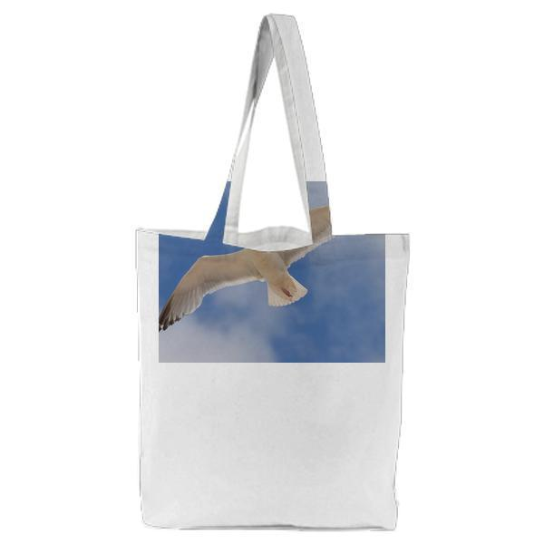White Bird Flying Under The Blue And White Sky During Daytime Tote Bag
