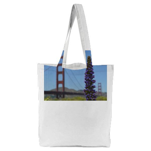 Purple Flower With The Golden Gate Bridge In Distance Tote Bag