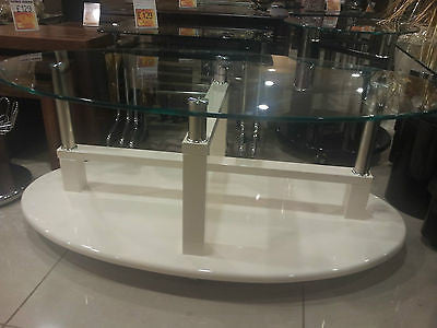 Coffee Table with High Gloss Clear Glass Top and lockable Wheels available in Black Brown Cream Red & White
