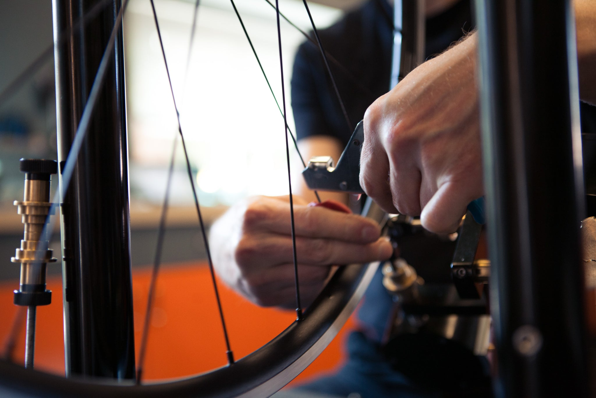 Michael building a custom bicycle wheel