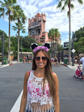 Girl wearing Rapunzel Mouse Ears at Disneyworld