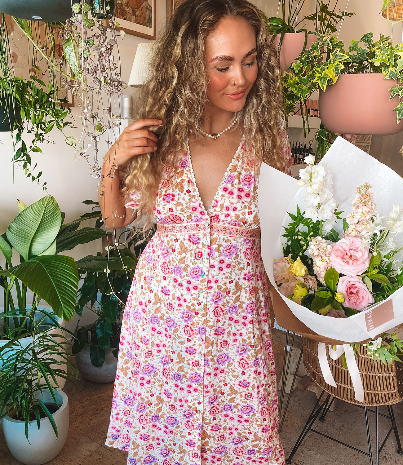 Buying flowers from Nikau Store Byron Bay wearing Arnhem clothing
