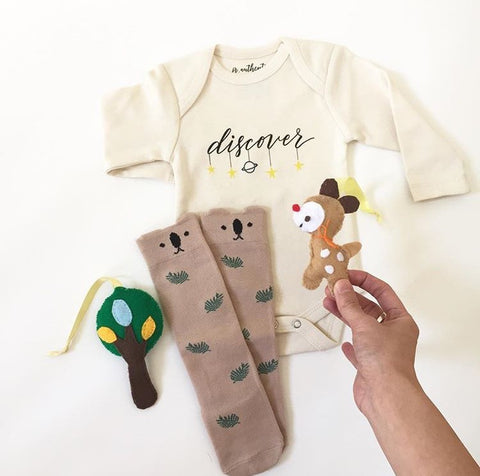 baby clothes flat lay instagram