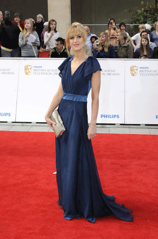 Katherine Kelly attends the 2011 BAFTAs in a James Steward dress
