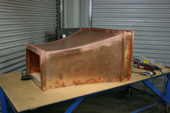 custom made copper range hood with clavos