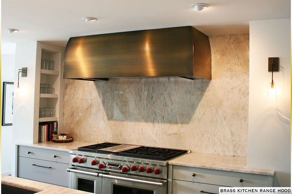 Brass kithcen range hood custom made in the USA by Havens Metal. Fully equipped ventilation system and liner blower.