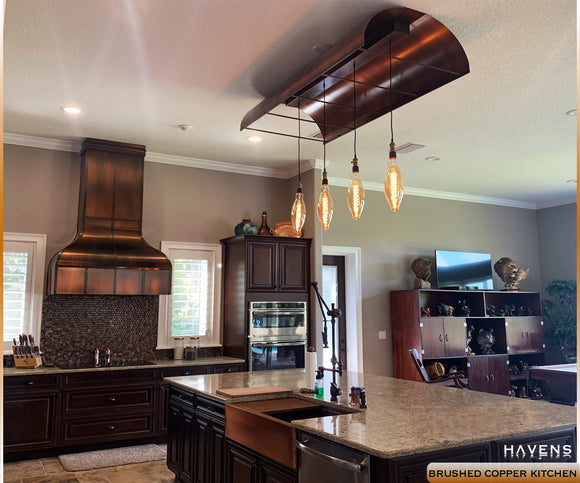 Rustic modern kitchen with luxury brushed copper details in the hood, sink, and lighting