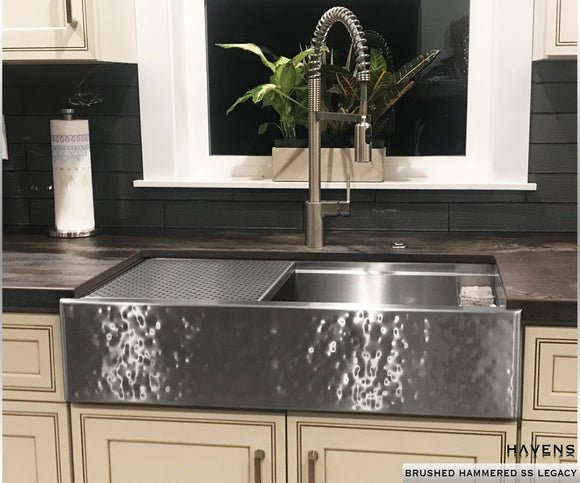 Hammered stainless steel farmhouse sink. Apron front sink with a hammered finish. Select undermount and farm sink sizes in the inches.