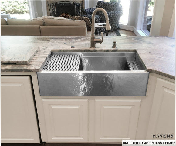 Stainless steel hammered farmhouse sink with a highly verstatile built in ledge, handcrafted in the USA by Havens.