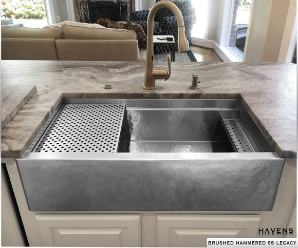 Brushed hammered custom stainless sink with a farmhouse apron front and built in ledge.