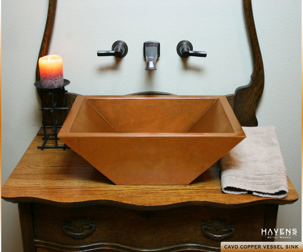 Copper vessel bathroom sink in a Havens client's bath area. Beautiful rustic luxury for the home lavatory.
