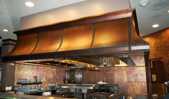 Hammered copper range hood built by Havens Metal for a commercial kitchen in Orlando, FL.
