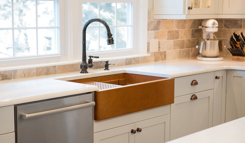 Kitchen sink buying guide - sink depths and metal types: copper and stainless steel.