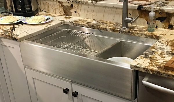 Farmhouse stainless steel sink installed in a kitchen, courtesy of Havens.
